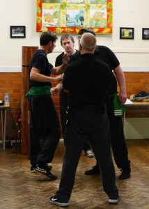 Old School Wing Chun Senior Students Discussing Drills